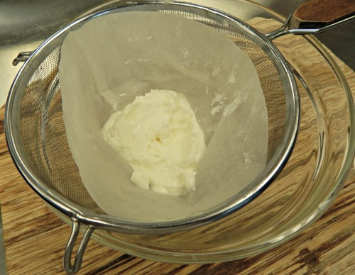thickened yogurt in strainer