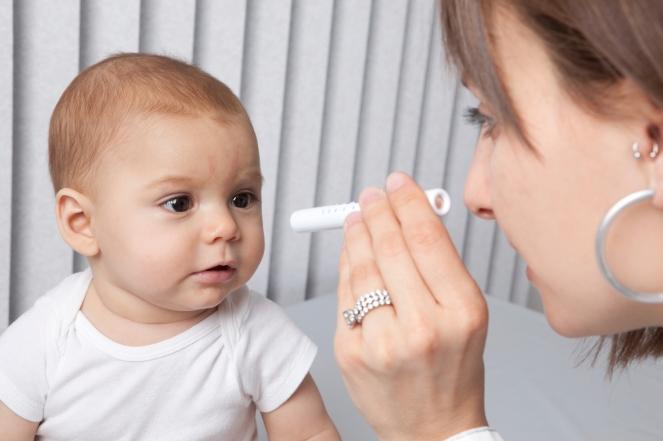 Pediatrician Checking Baby's Eyes