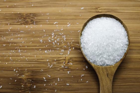 Wooden spoonful of salt