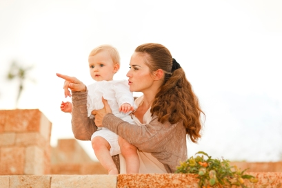 Parent holding baby pointing at something
