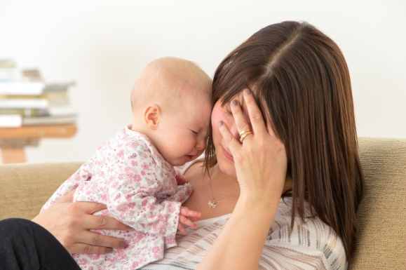 tired-mom-holding-baby-istock_000040601458_large