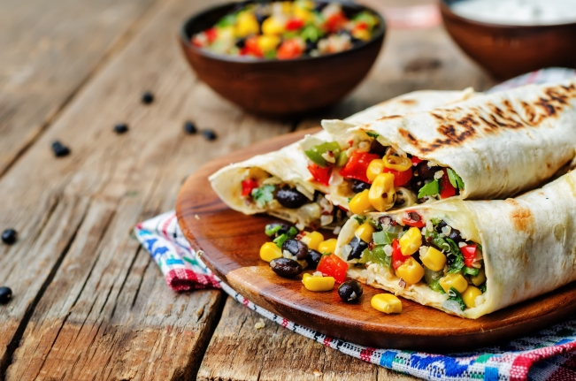 healthy bean quinoa wrap on dark wood background