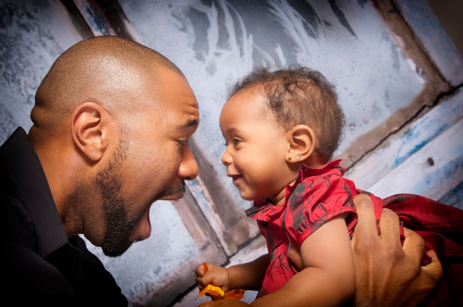 father and daughter smiling at each other