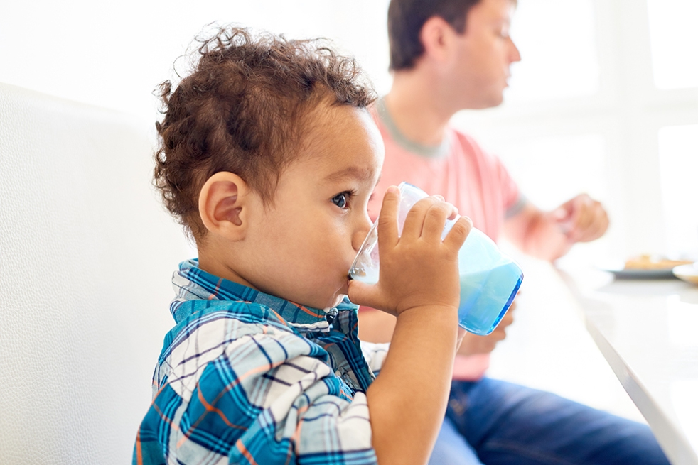 Toddler drinking milk from cup