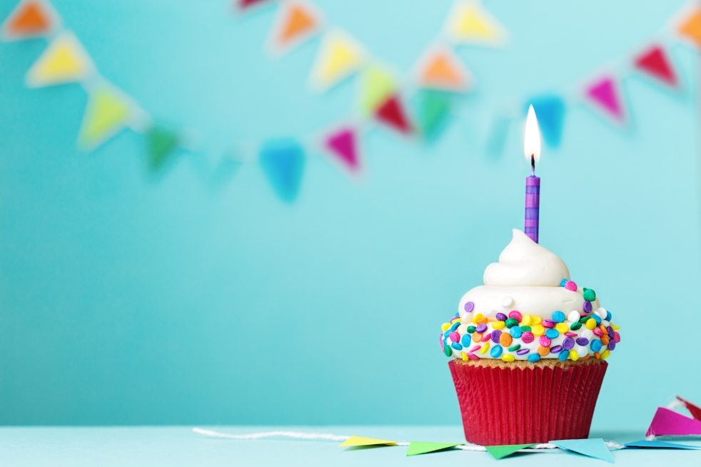 Colorful cupcake with single birthday candle