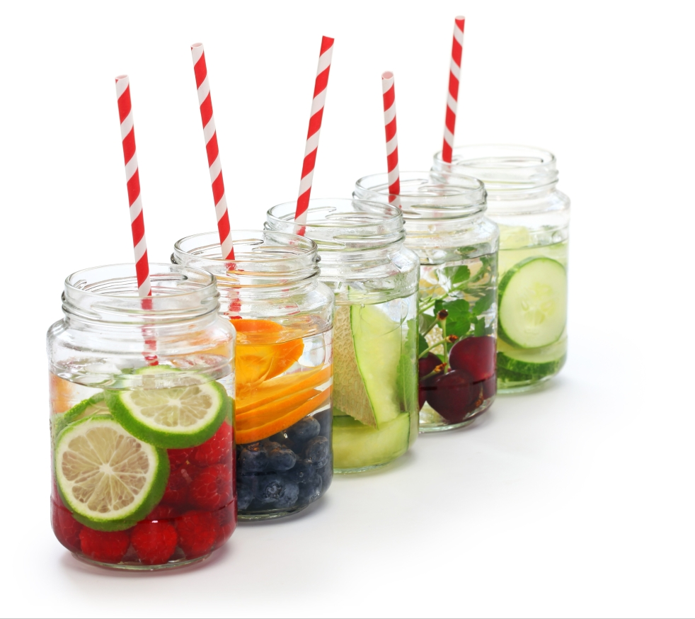 Fruit infused water in mason jars with straw