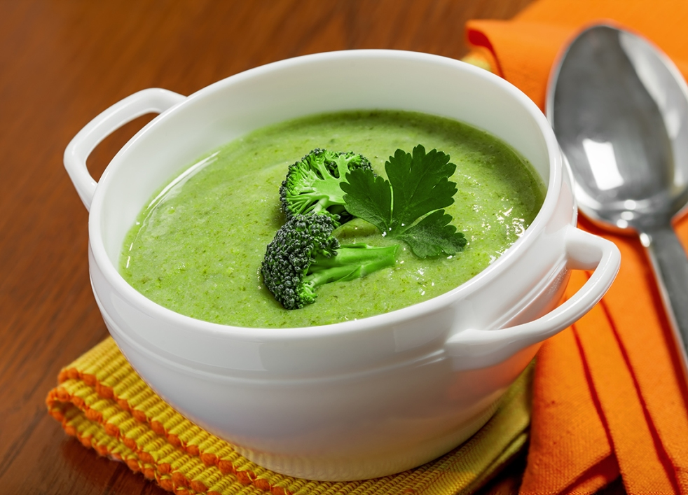 Broccoli cream soup in a white bowl