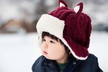 Toddler wearing hat outdoors-2859669_1920