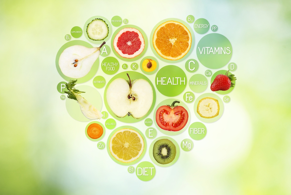 Fruit symbols in hearth shape on green background