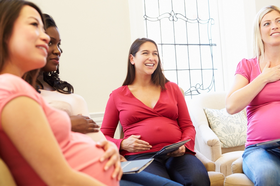 Pregnant individuals Smiling In Meeting At Prenatal program