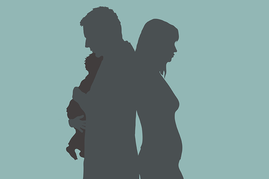 Shadow of two individuals standing back to back holding baby