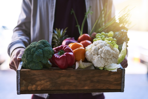 Fresh fruit and veggies in wooden crate