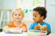 Preschoolers eating snack.