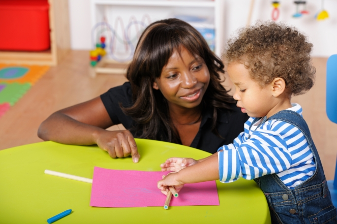 Childminder/Carer Supervising Toddler During An Art And Craft Session