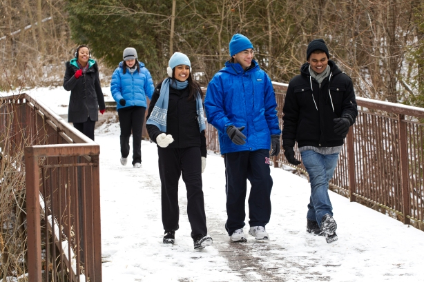 group of young adults walking outside during winter