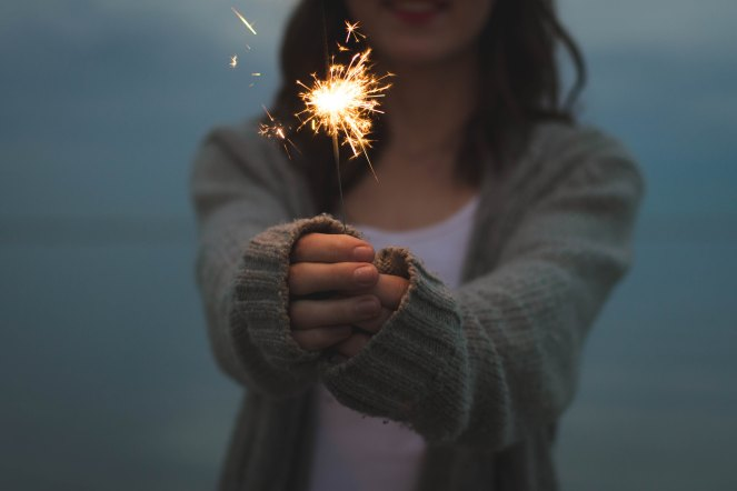 Individual holding a sparkler