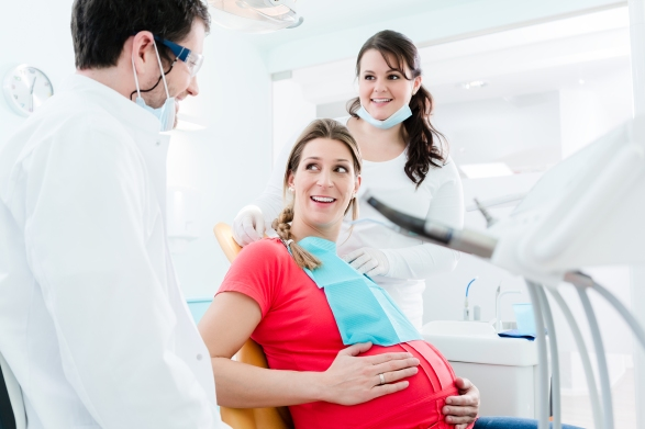 Pregnant woman at dentist before treatment