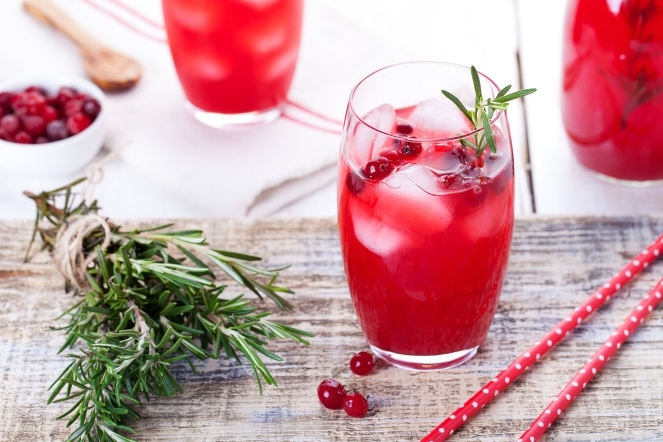 Cranberry and rosemary lemonade, cocktail, fizz on a wooden background