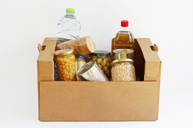 Food in an open brown box, isolated in a white background