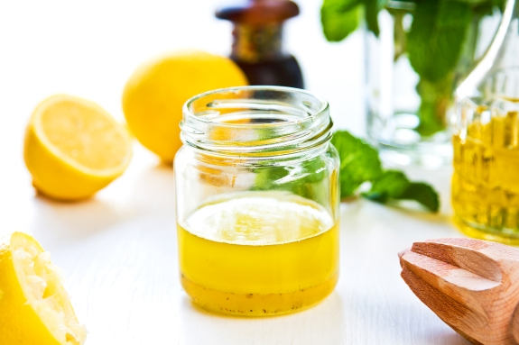 Homemade vinaigrette with fresh ingredients in small glass jar