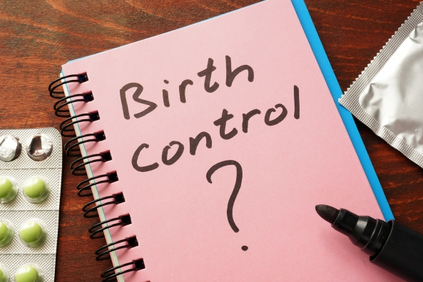 Notebook with the words Birth control  on the table.
