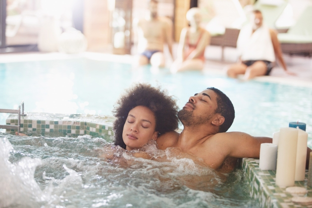Young couple is relaxing in a hot tub