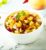 Mango salsa in a white bowl