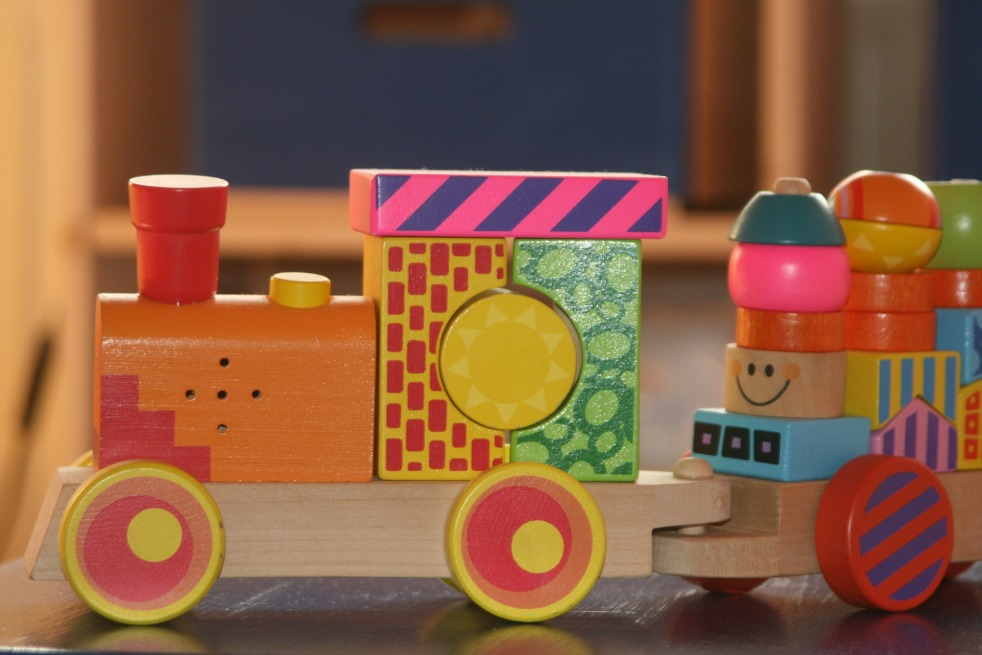 Wooden toy train painted in bright colours