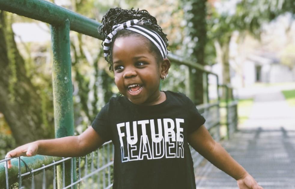 Toddler smiling while walking outdoors